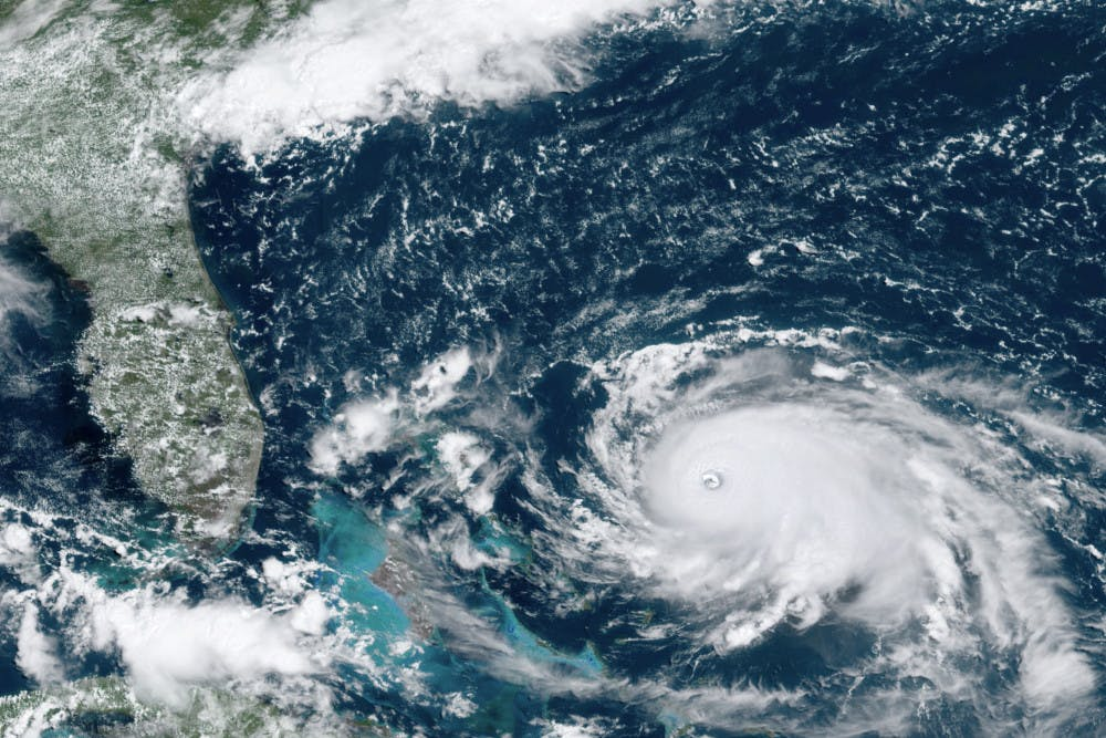 <p>This GOES-16 satellite image taken Saturday, Aug. 31, 2019, at 16:00 UTC and provided by National Oceanic and Atmospheric Administration (NOAA), shows Hurricane Dorian, right, churning over the Atlantic Ocean. Hurricane Dorian bore down on the Bahamas as a fierce Category 4 storm Saturday, with new projections showing it curving upward enough to potentially spare Florida a direct hit but still threatening parts of the Southeast U.S. with powerful winds and rising ocean water that causes what can be deadly flooding.(NOAA via AP)</p>