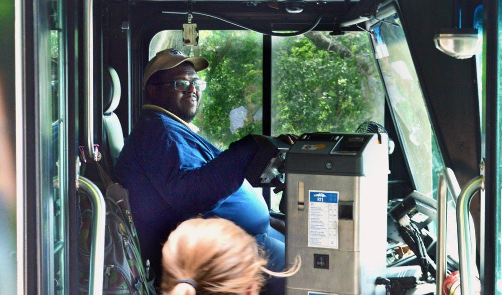 """<p dir=""""ltr""""><span>Desmond Grimes, 38, welcomes students onto the 117 Bus at the Reitz Union. Grimes' route, """"Park-N-Ride 2,"""" circulates through 34th Street back to the Reitz Union. </span></p><p><span></span></p>"""
