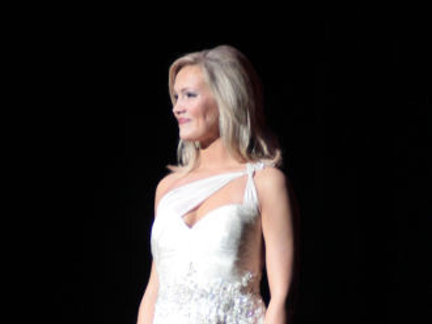 Telecommunication sophomore Elizabeth Fechtel of Alpha Delta Pi displays her choice of evening wear during Miss UF 2014 at the Curtis M. Phillips Center for the Performing Arts on Monday night.