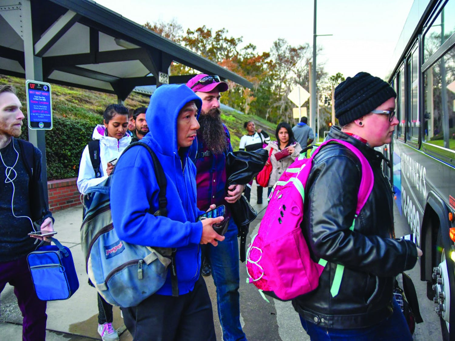 A group of passengers wearing heavy jackets and long pants board a Regional Transit System bus on Newell Drive on Monday, Jan. 9, 2017. At the time, the temperature was already in the mid-50s and predicted to drop later that night.