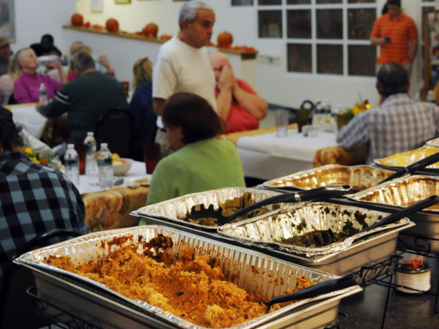 Guests dine at a Thanksgiving-style feast Thursday evening at Gainesville's American Cancer Society Winn-Dixie Hope Lodge. Winn-Dixie hosted the dinner.
