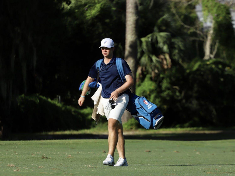 Florida golfer Tyler Wilkes walks down a fairway at Mark Bostick Golf Club. The Florida men's golf team released its 2021-22 schedule Friday.