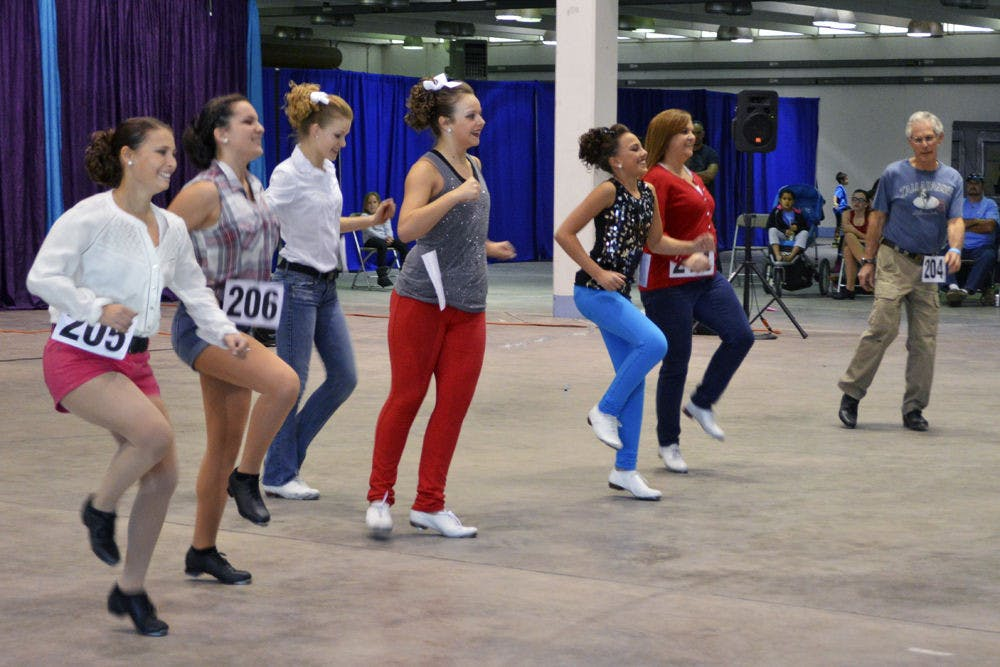 <p>A group of clog dancers performs at Gainesville's first clogging festival, which was on the Alachua County Fairgrounds on Saturday. Eight teams competed in the Florida Clogging Festival and will advance to two national competitions.</p>