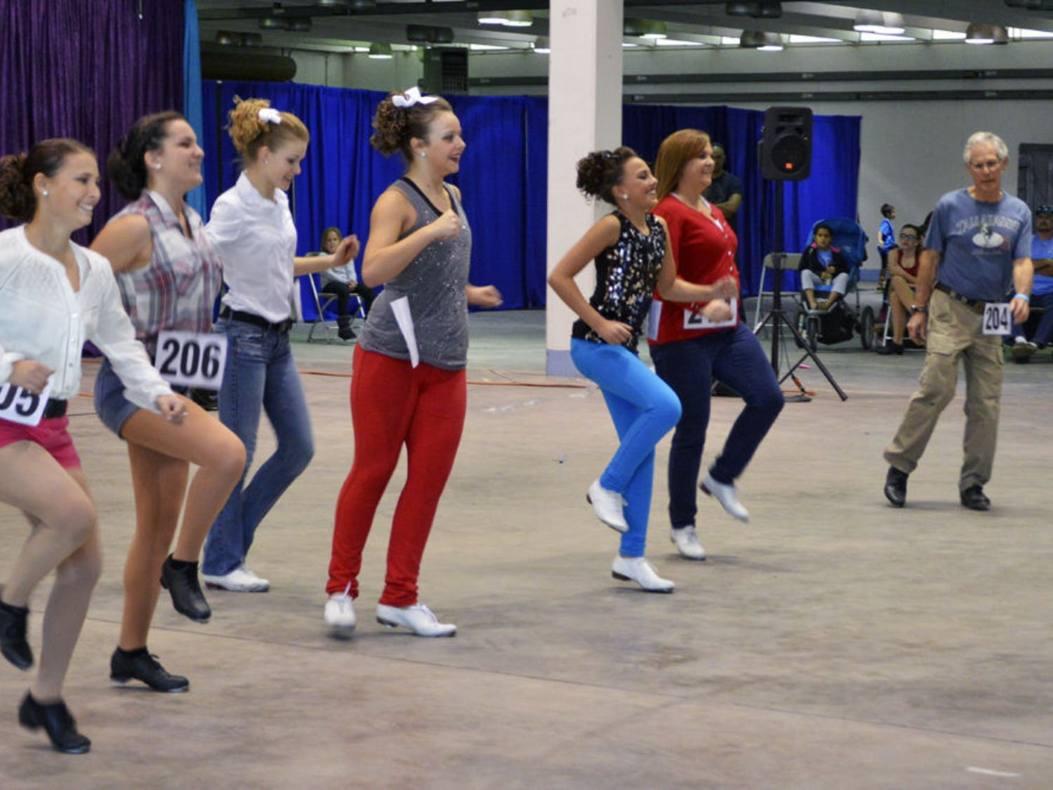 A group of clog dancers performs at Gainesville's first clogging festival, which was on the Alachua County Fairgrounds on Saturday. Eight teams competed in the Florida Clogging Festival and will advance to two national competitions.
