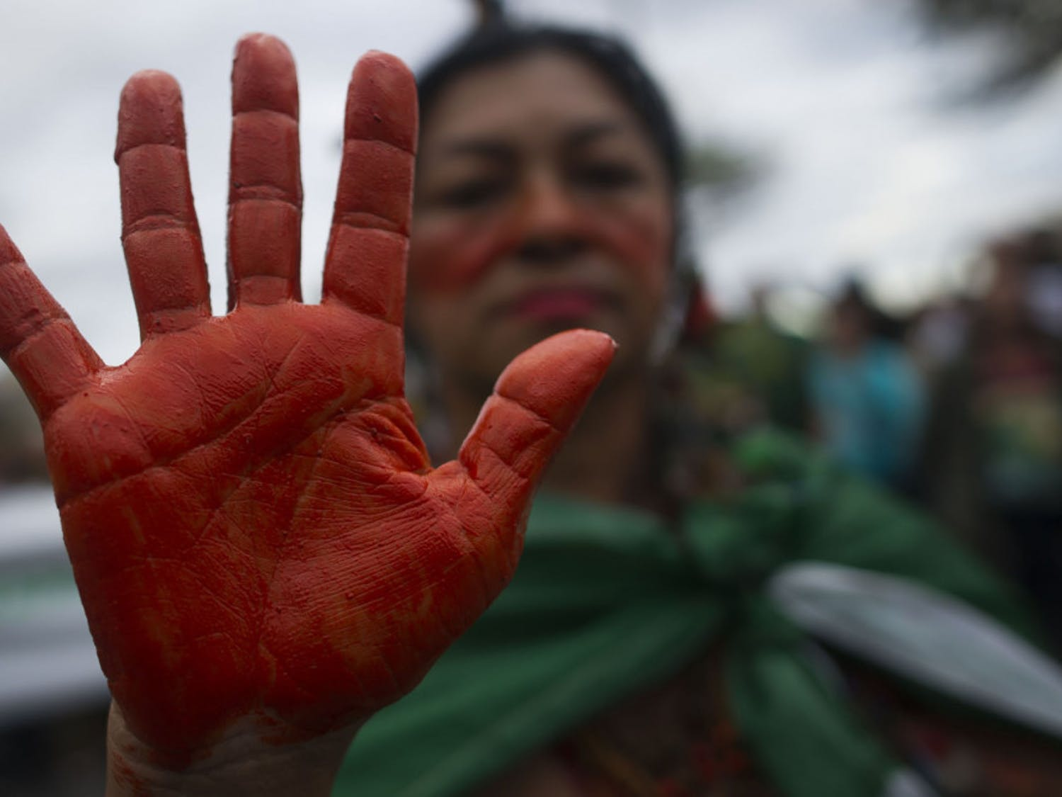 An indigenous woman shows her hands painted in red, representing blood, during a protest in defense of the Amazon while wildfires burn in that region, in Rio de Janeiro, Brazil, Sunday, Aug, 25, 2019. Experts from the country's satellite monitoring agency say most of the fires are set by farmers or ranchers clearing existing farmland, but the same monitoring agency has reported a sharp increase in deforestation this year as well. (AP Photo/Bruna Prado)