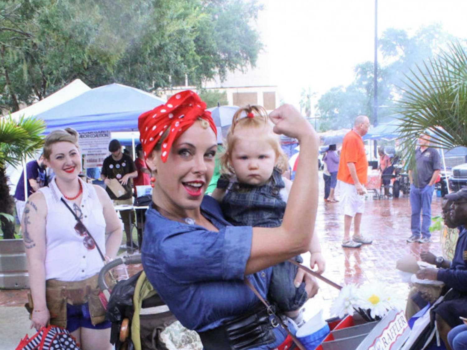 Jill Dumas, a 39-year-old Gainesville resident, sells raffle tickets to festival attendees during the Labor Daze Fest on Sunday. The grand prize winner received up to $500 of their power bill paid for by Gainesville Regional Utilities.