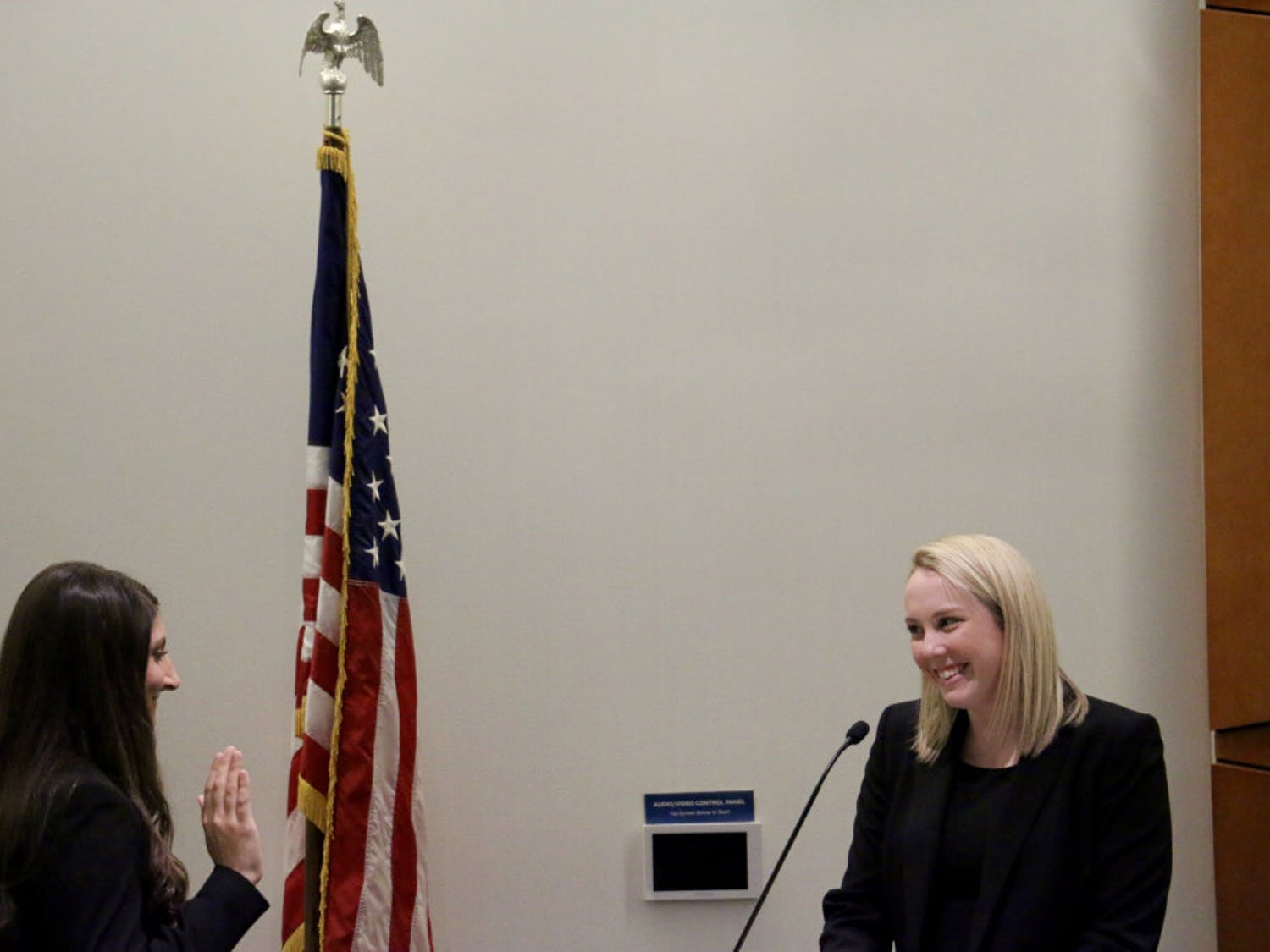 "New UF Student Senate President Danielle Grosse stands before the senators as she is sworn in on Tuesday evening in the Reitz Union Chamber Room. ""There will always be more that we can accomplish as student senators, and I am excited to get to work with you all to achieve these things,"" Grosse said."