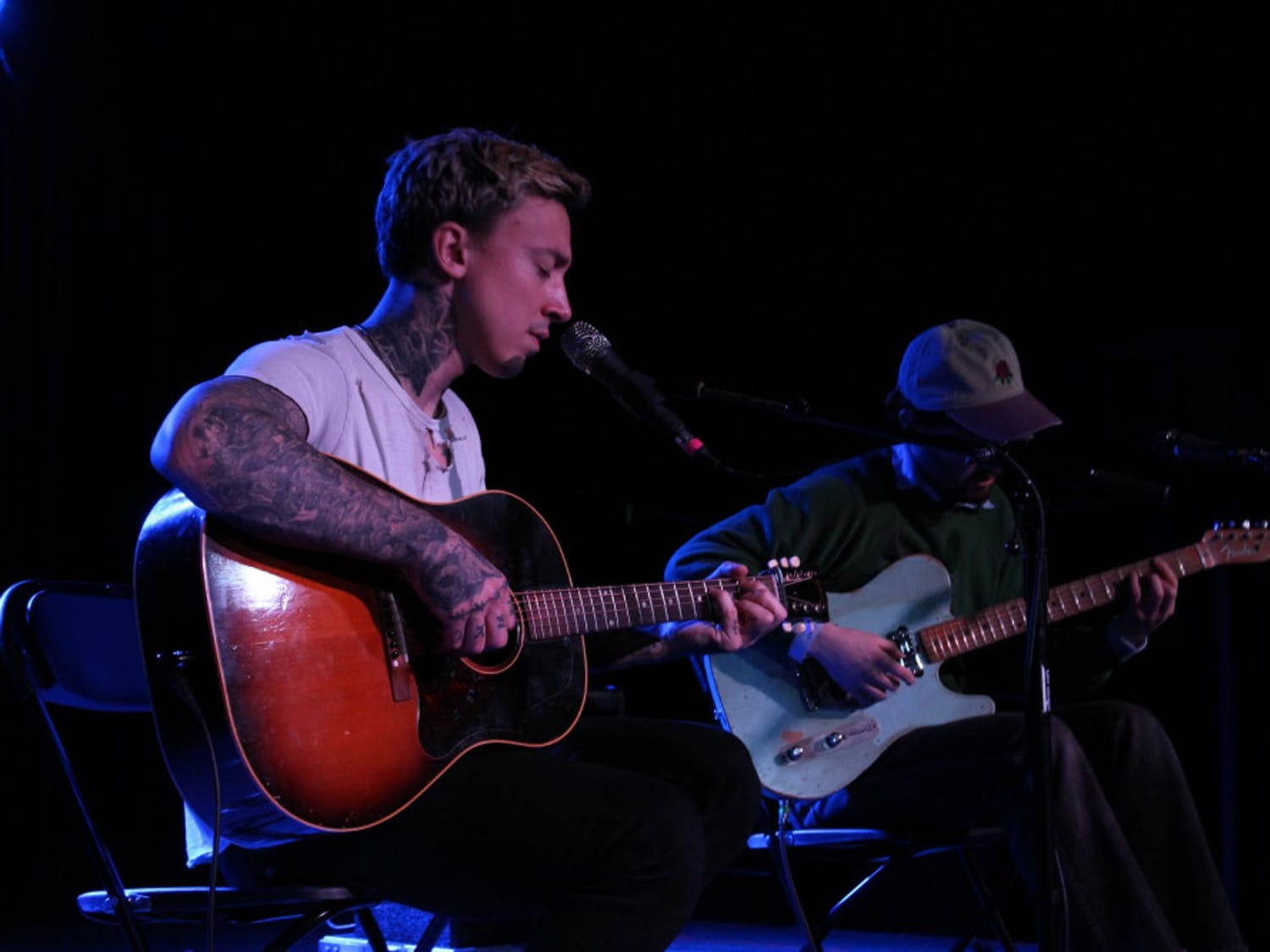 Musicians Noah Gundersen (left) and Harrison Whitford (right) collaborate during an acoustic performance on Sunday.