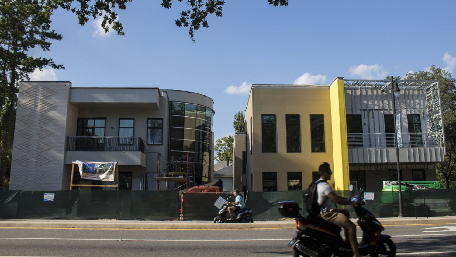 Students pass in front of the location of the newly renovated IBC and La Casita buildings.