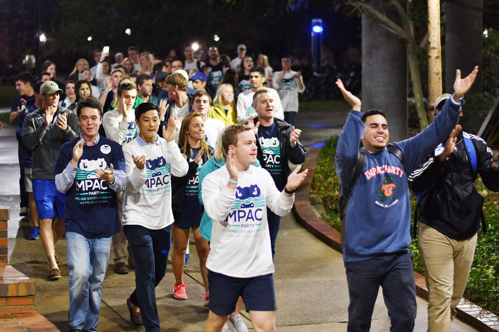 """<p>The Impact Party walks to the Reitz Union Breezeway on Feb. 22, 2017, chanting """"I-M-P-A-C-T. Impact is for you and me."""" The Impact Party won 48 seats in the Spring 2017 election.</p>"""