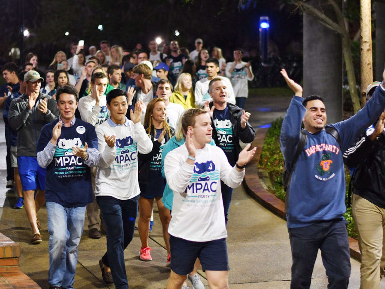 "The Impact Party walks to the Reitz Union Breezeway on Feb. 22, 2017, chanting ""I-M-P-A-C-T. Impact is for you and me."" The Impact Party won 48 seats in the Spring 2017 election."