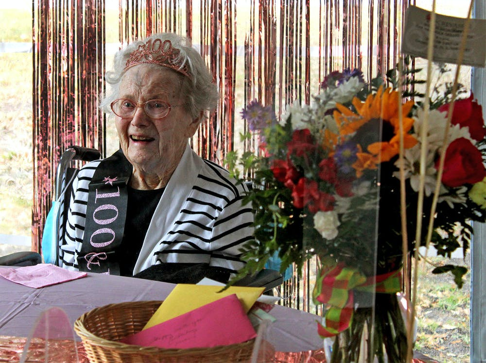 <p>Marion Broadaway smiles as she tells stories of her life to family members and reporters at her 100th birthday celebration on Friday, Feb. 5, 2021.</p>