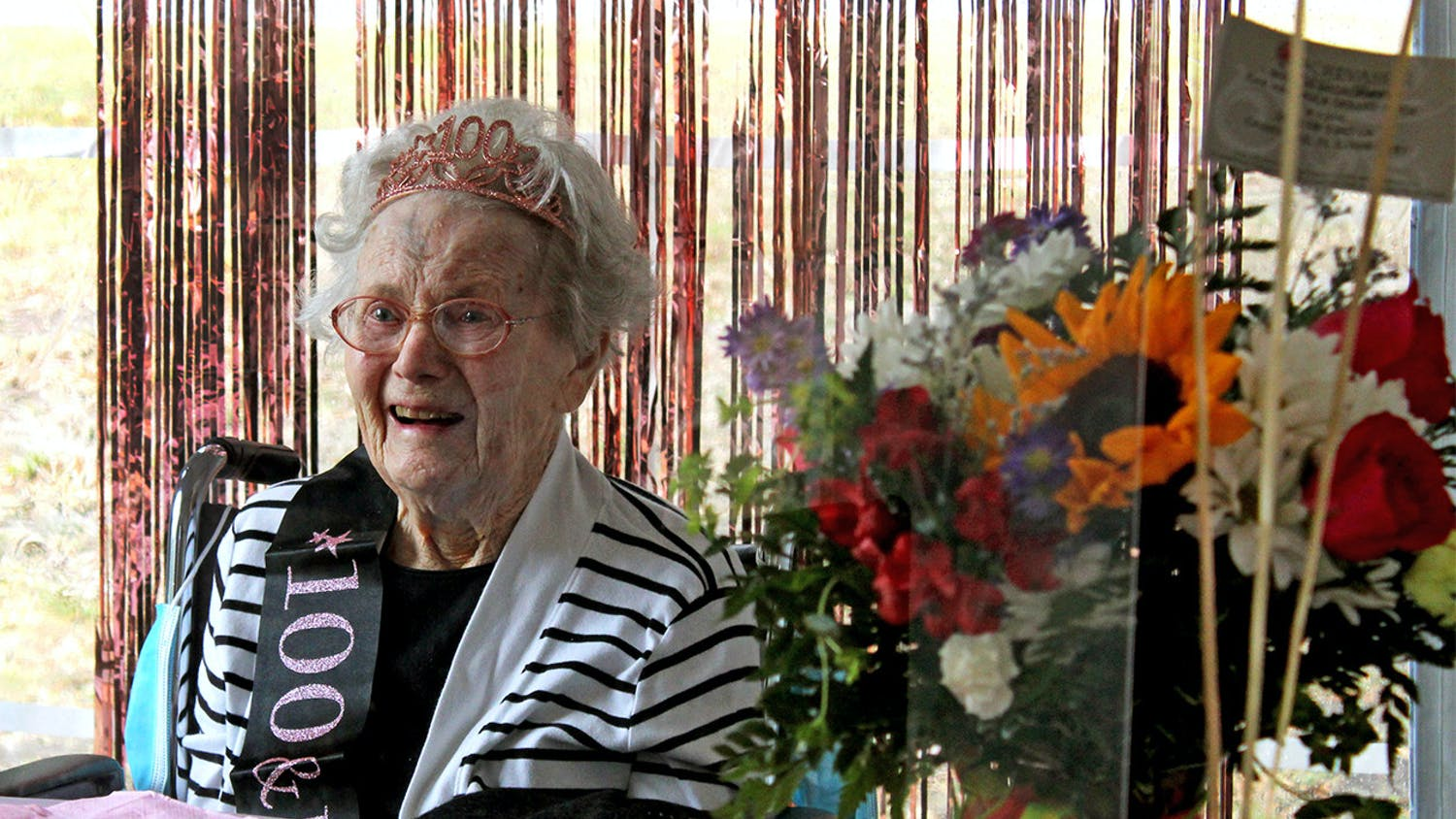 Marion Broadaway smiles as she tells stories of her life to family members and reporters at her 100th birthday celebration on Friday, Feb. 5, 2021.