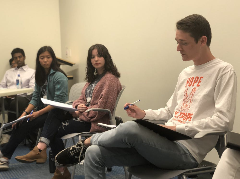 <p>Candidates Emma Sanchez (left), Zoe Terner (middle) and Nick Meyer (right) deliver their closing remarks at a debate between Inspire and Gator parties' liberal arts and sciences candidates on Monday night.</p>
