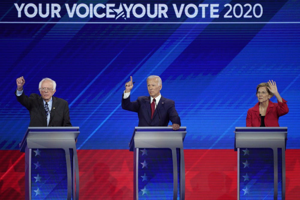 <p>From left, Democratic presidential candidates Sen. Bernie Sanders, I-Vt., former Vice President Joe Biden and Sen. Elizabeth Warren, D-Mass. raise their hands to answer a question Thursday, Sept. 12, 2019, during a Democratic presidential primary debate hosted by ABC at Texas Southern University in Houston. (AP Photo/David J. Phillip)</p>
