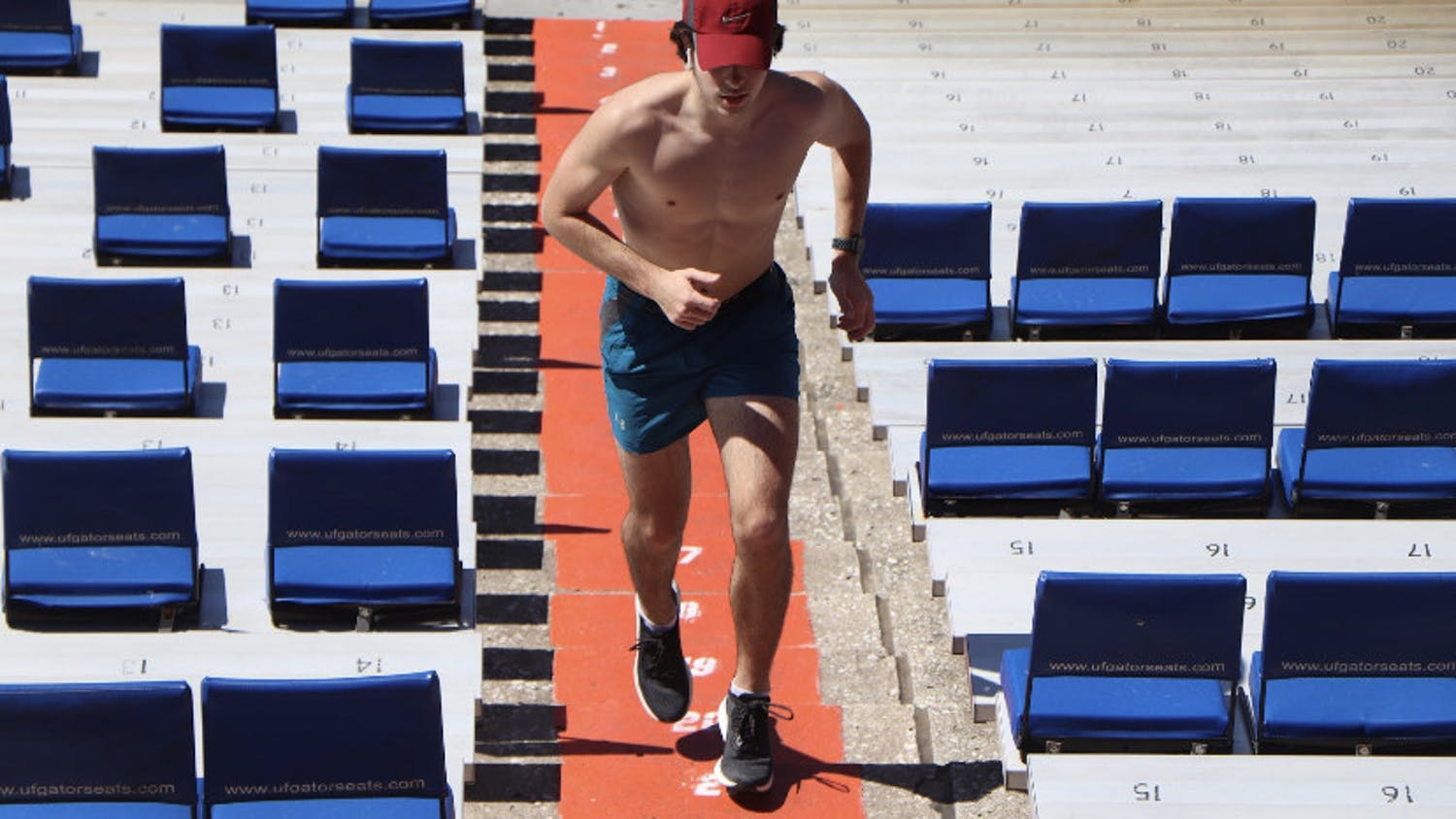 Adam Conybear, a 21-year-old junior studying computer science, runs up the stairs at Ben Hill Griffin Stadium on March 9.