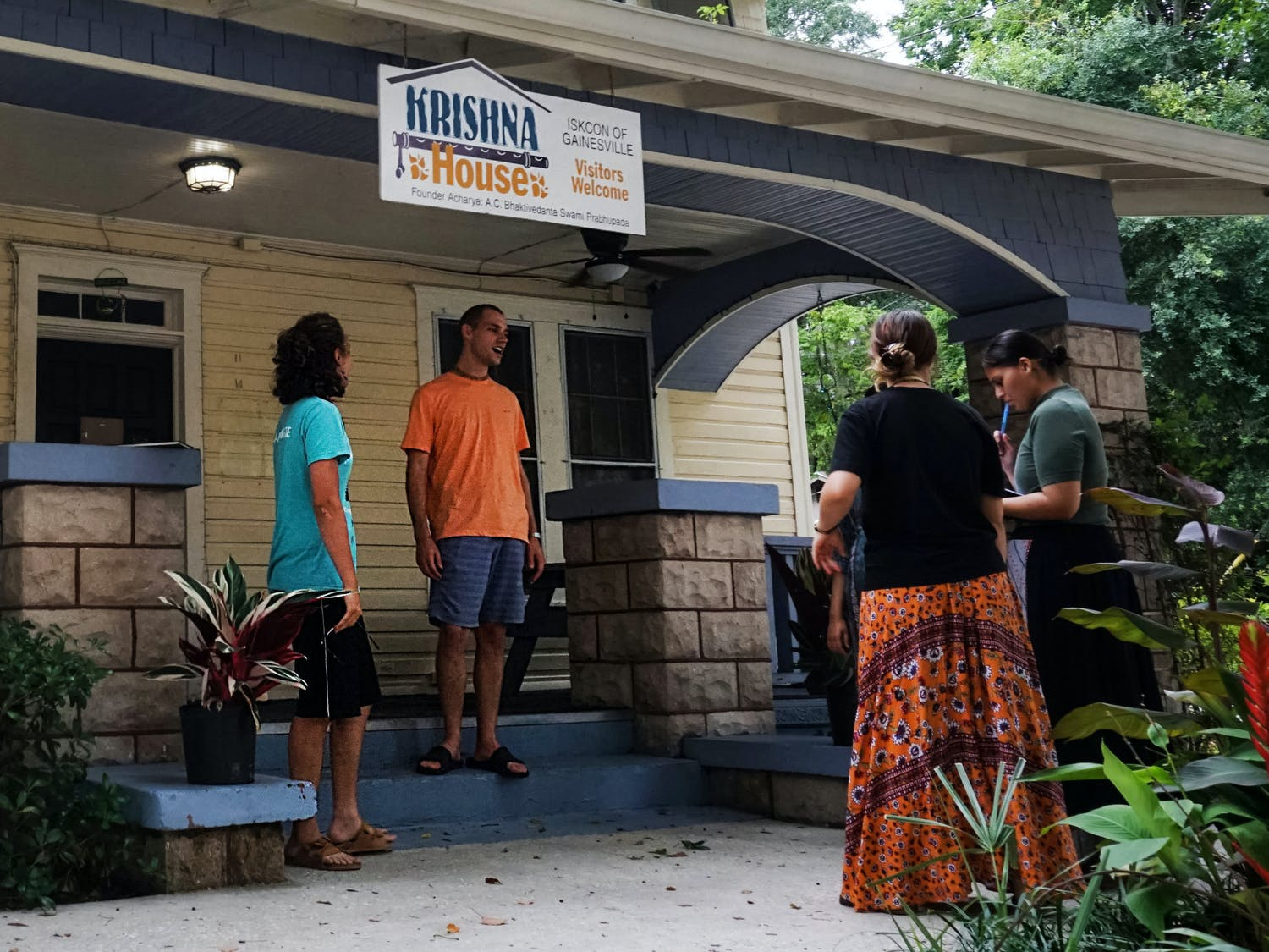 A group of Hare Krishnas gathered outside the Krishna House at 214 NW 14th Street in Gainesville on Thursday, July 29, 2021. The Gainesville community is celebrating the 50th anniversary of Krishna Lunch at UF this weekend.