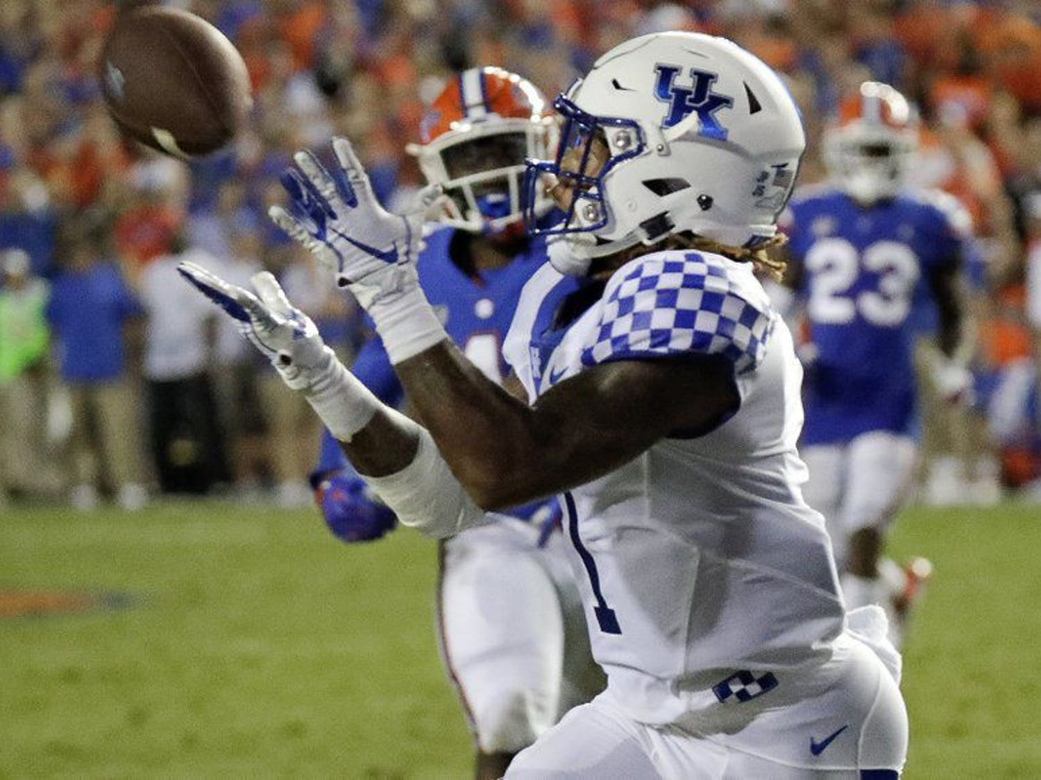 Lynn Bowden caught a 54-yard touchdown from quarterback Terry Wilson late in the third quarter. The Wildcats took a 21-10 advantage over UF, surging to a 27-16 victory in The Swamp.