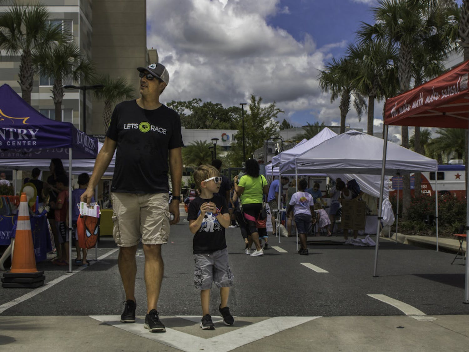 Celebration Pointe was lined with booths and vendors on Saturday as part of a Back to School Bash co-sponsored by Fun 4 Gator Kids, an organization that posts lists of local children's activities, and the shopping center. The event was created to give children an afternoon of fun activities and a chance to interact with local businesses before Alachua County Schools begin classes on Aug. 12. The event featured fencing and archery demonstrations, charity drives, food and refreshments from vendors and a bounce house.