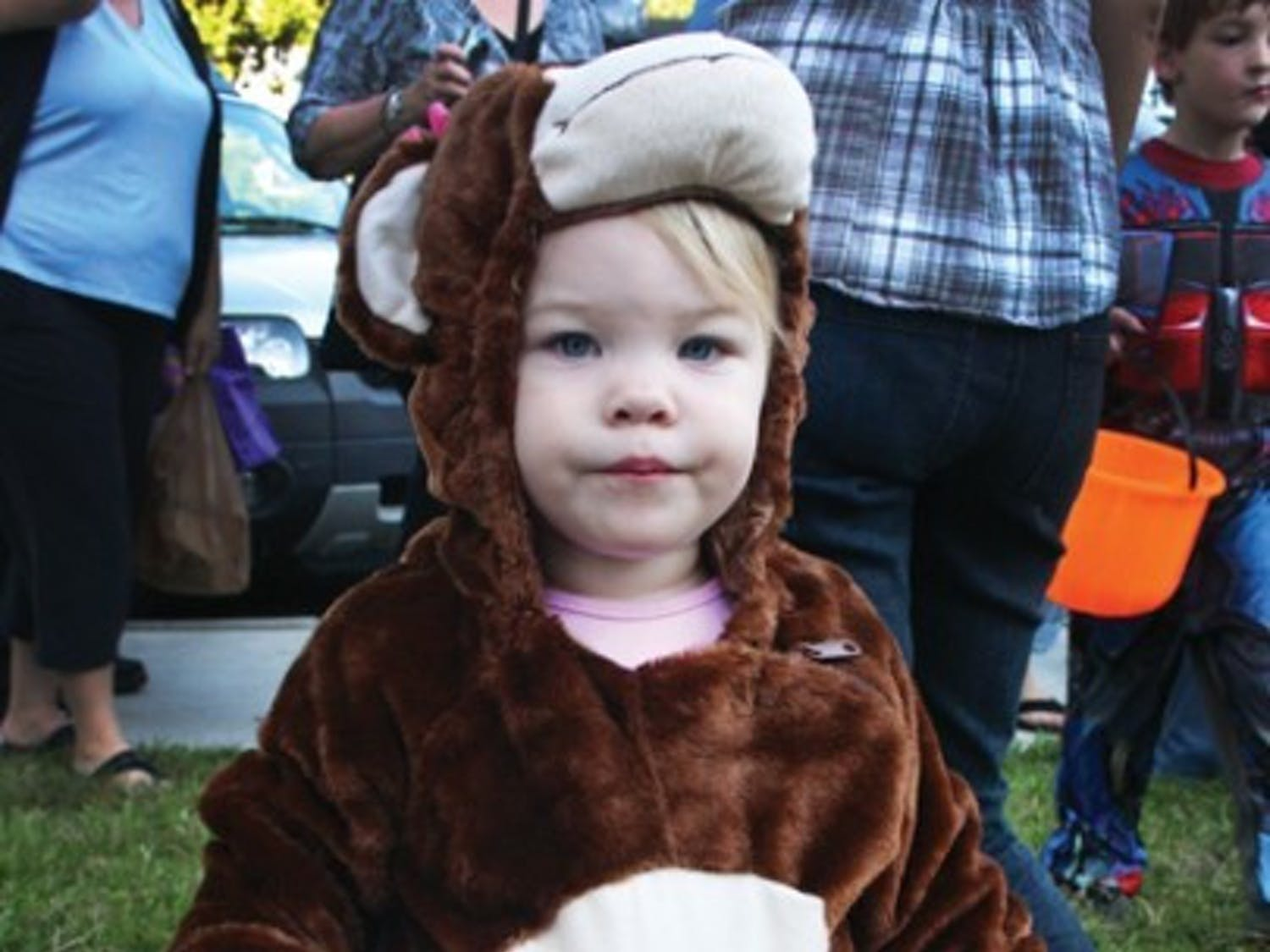 Mackenzie Mavin, 22 months, trick-or-treats outside the Alpha Chi Omega sorority house at Ghouls, Goblins and Greeks on Thursday.