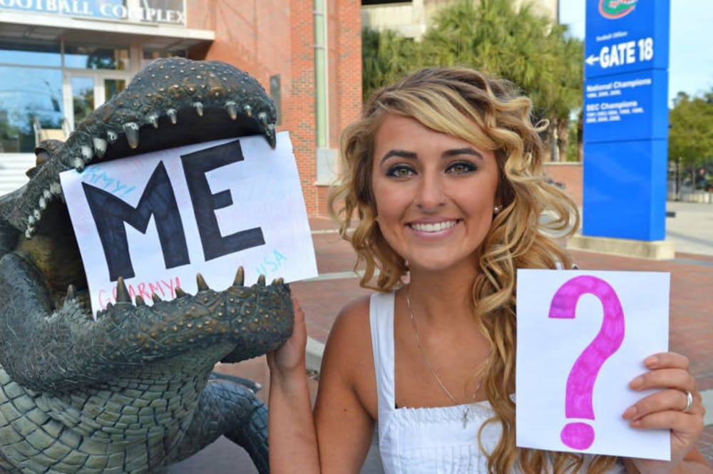 """<p class=""""p1"""">Keira Hornyak poses with some of the signs she used to ask Tim Tebow to the UF Military Ball. Hornyak wants Tebow to help endorse a cystic fibrosis fundraiser.</p>"""