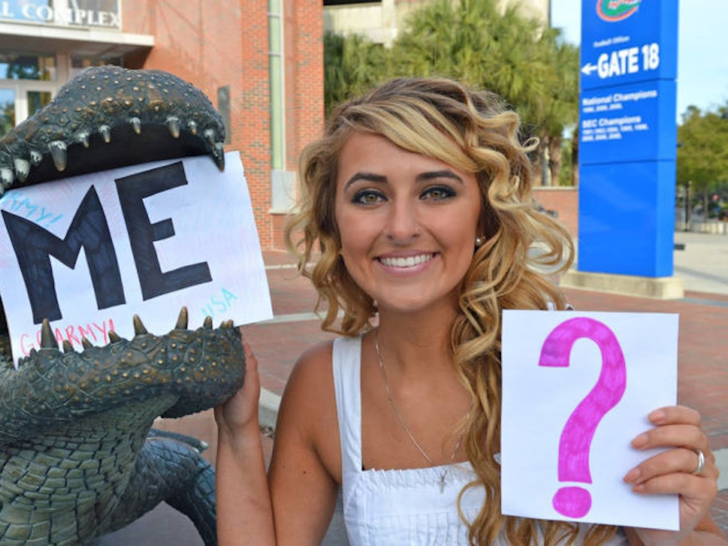 Keira Hornyak poses with some of the signs she used to ask Tim Tebow to the UF Military Ball. Hornyak wants Tebow to help endorse a cystic fibrosis fundraiser.