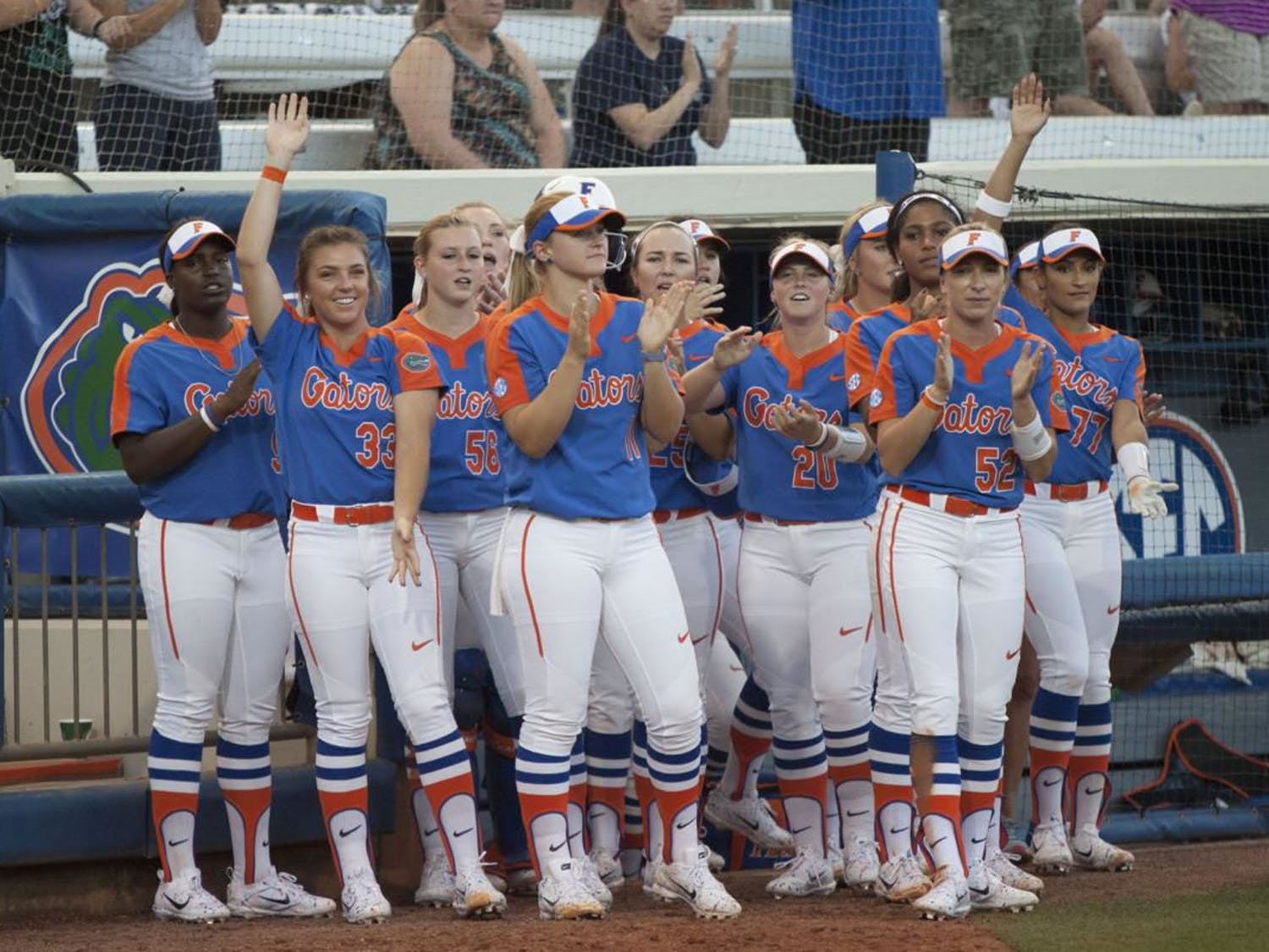 The Gators applaud outside of their dugout during a game last season
