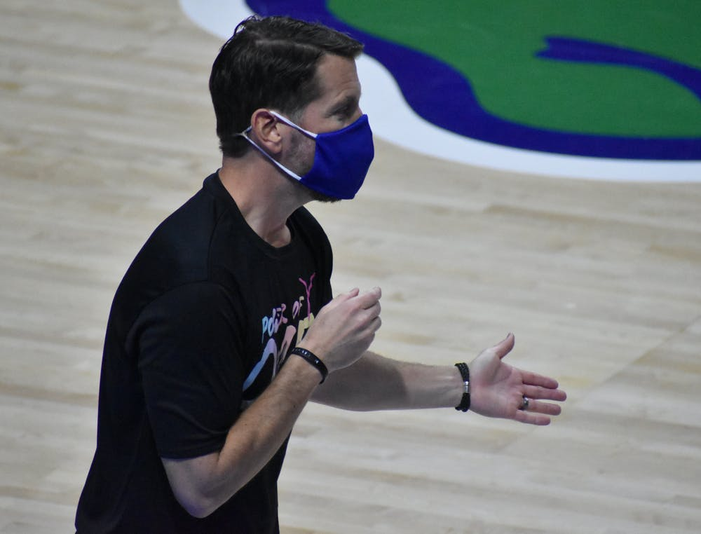 <p>Cameron Newbauer coaching against Kentucky on Feb. 15. Newbauer announced he is stepping down as head coach of the Gators Friday.</p>