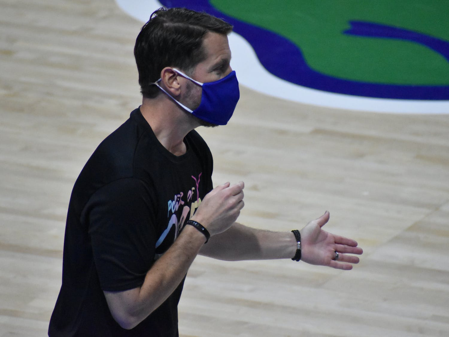 Cameron Newbauer coaching against Kentucky on Feb. 15. Newbauer announced he is stepping down as head coach of the Gators Friday.