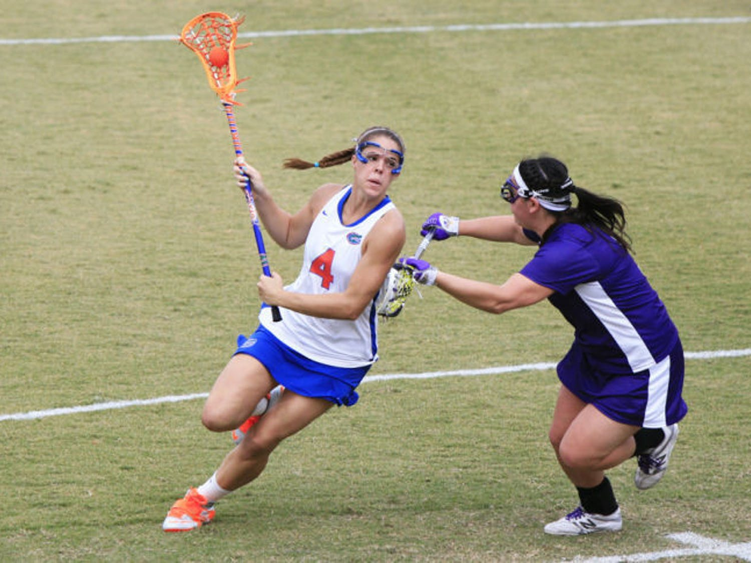 Senior attacker Kitty Cullen looks to score against UAlbany on Feb. 24 at Donald R. Dizney Stadium. Cullen scored two goals in her final game for the Gators.