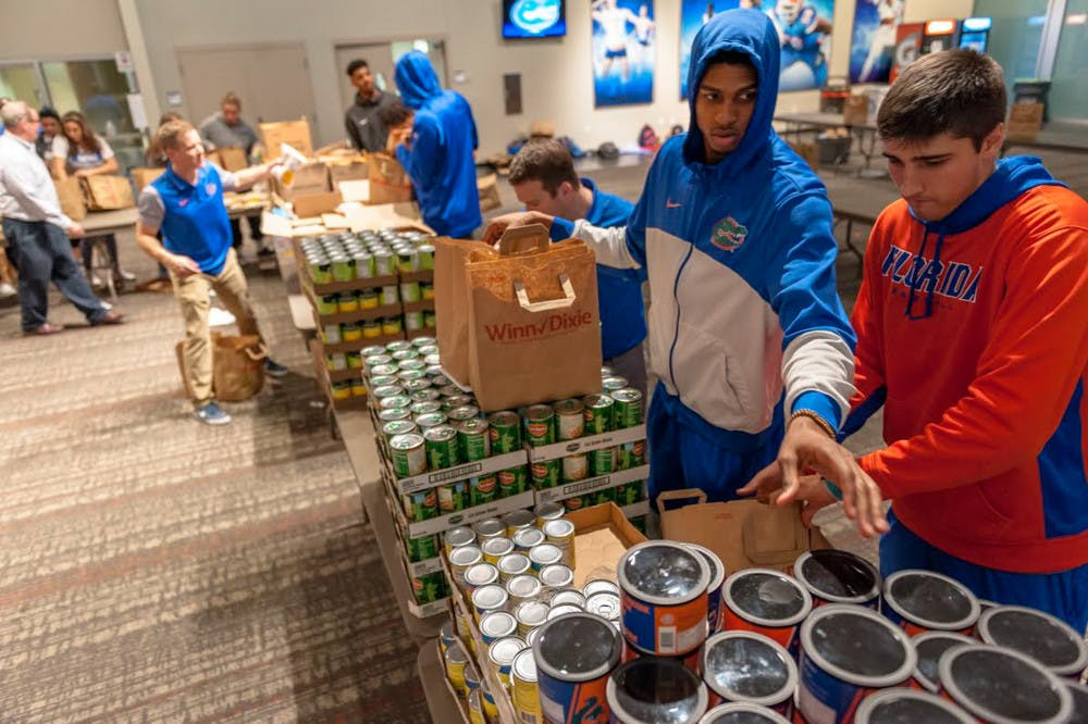 <p>The University Athletic Association works with Grace Marketplace and Catholic Charities to find the homeless and families in need. On Monday, UF athletes filled 1,200 Winn-Dixie bags with Thanksgiving food — enough to feed 600 local families.</p>