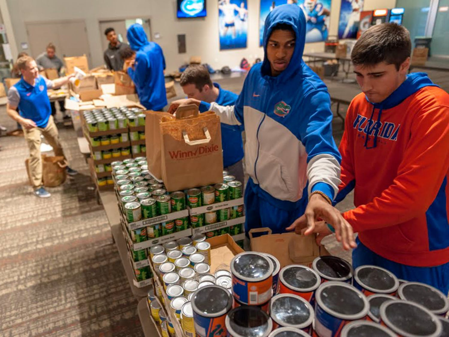 The University Athletic Association works with Grace Marketplace and Catholic Charities to find the homeless and families in need. On Monday, UF athletes filled 1,200 Winn-Dixie bags with Thanksgiving food — enough to feed 600 local families.