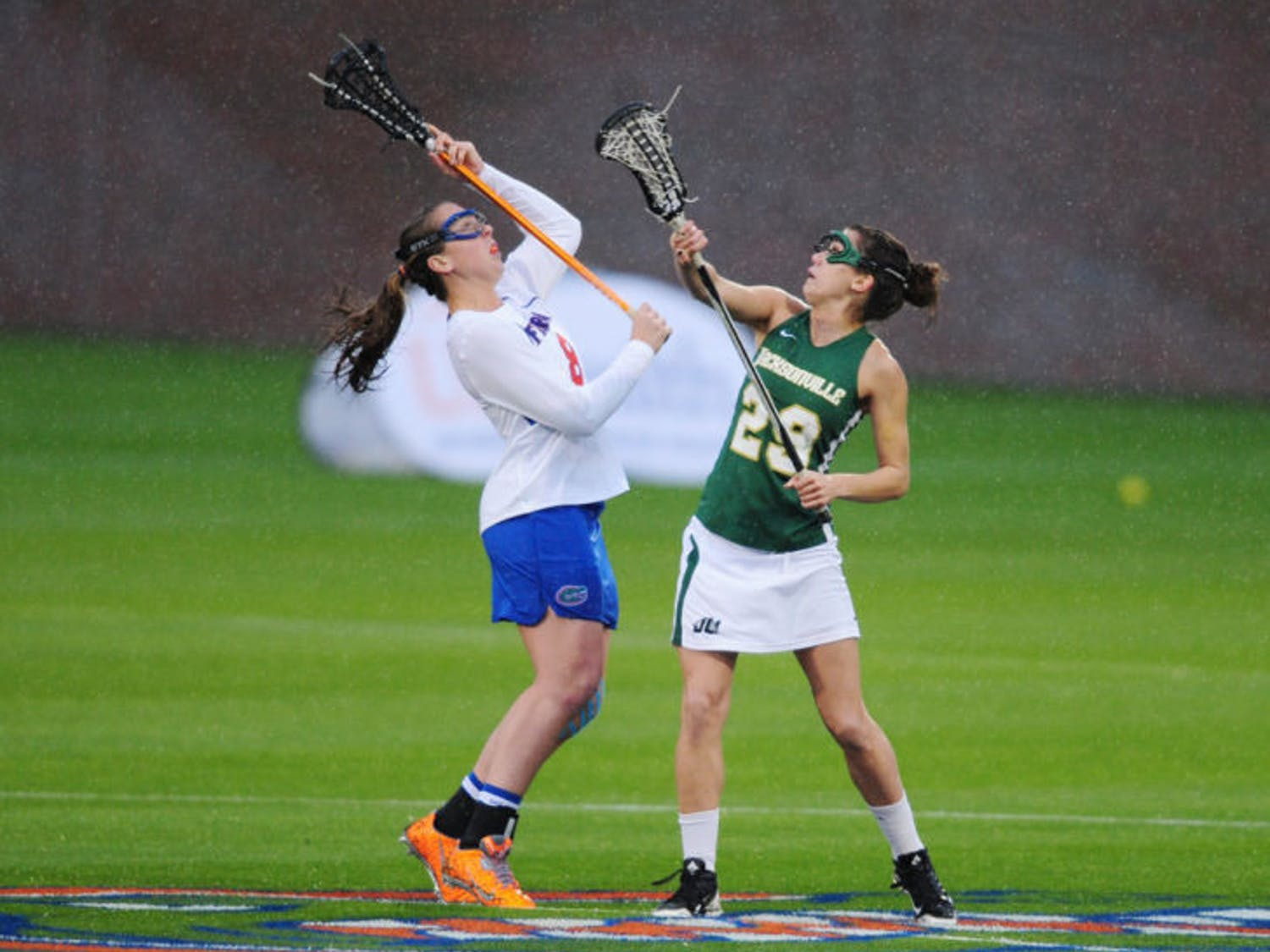 Shannon Gilroy fights for the ball during Florida's 21-5 win against Jacksonville on Feb. 12 at Donald R. Dizney Stadium. Gilroy leads the Gators with 35 goals this season.