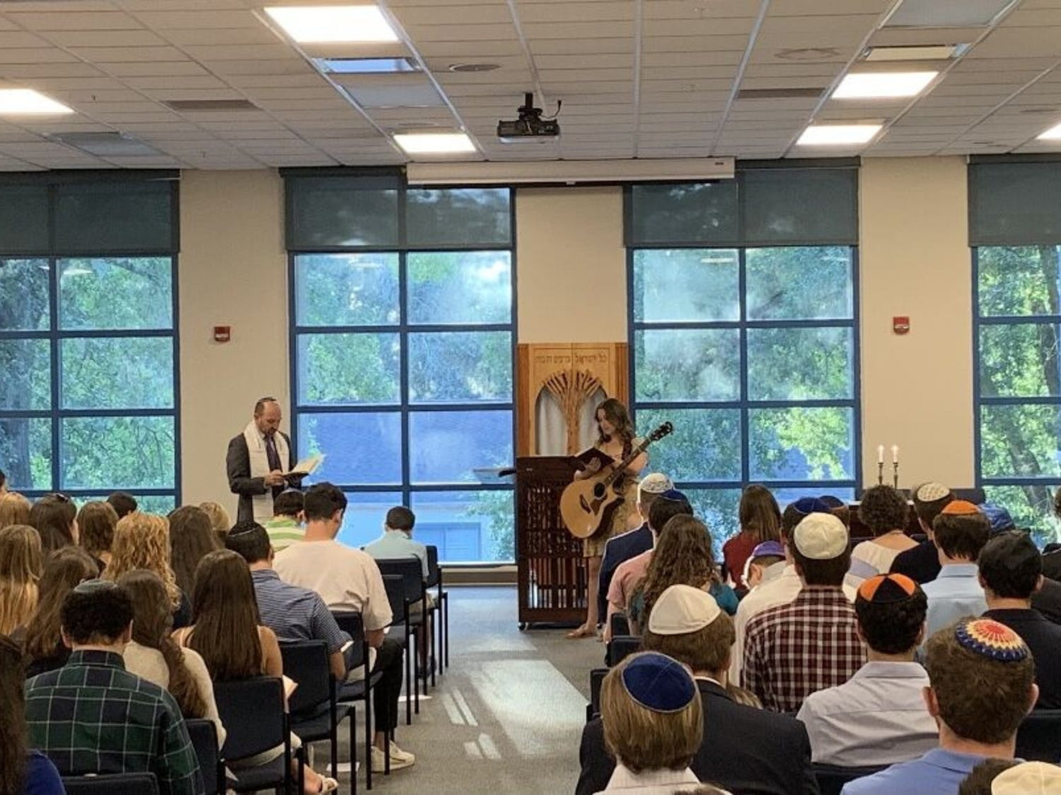 Rabbi Jonah Zinn leads High Holy Day services at UF Hillel last year.