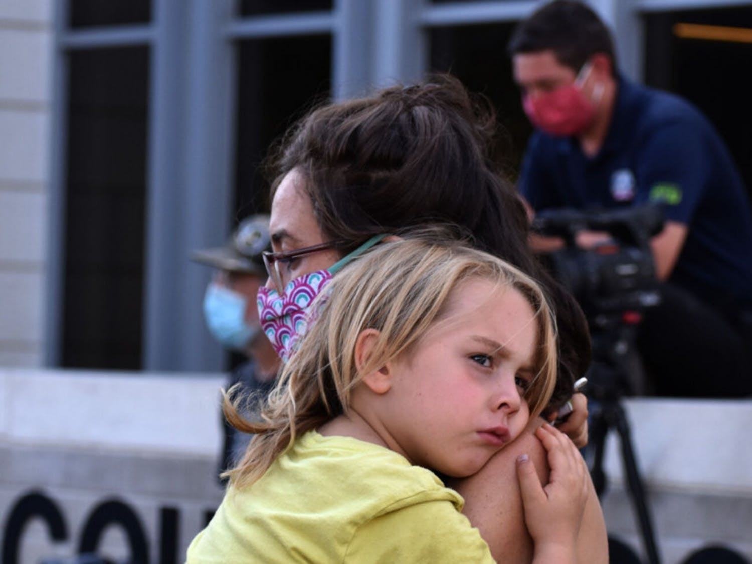 Meg Sullivan, 32, a Gainesville resident, is seen holding her six-year-old son, whom she did not want to be named, at the protest for Breonna Taylor at the Alachua County Court House on Saturday, Sept. 26, 2020. (Asta Hemenway/Alligator Staff)