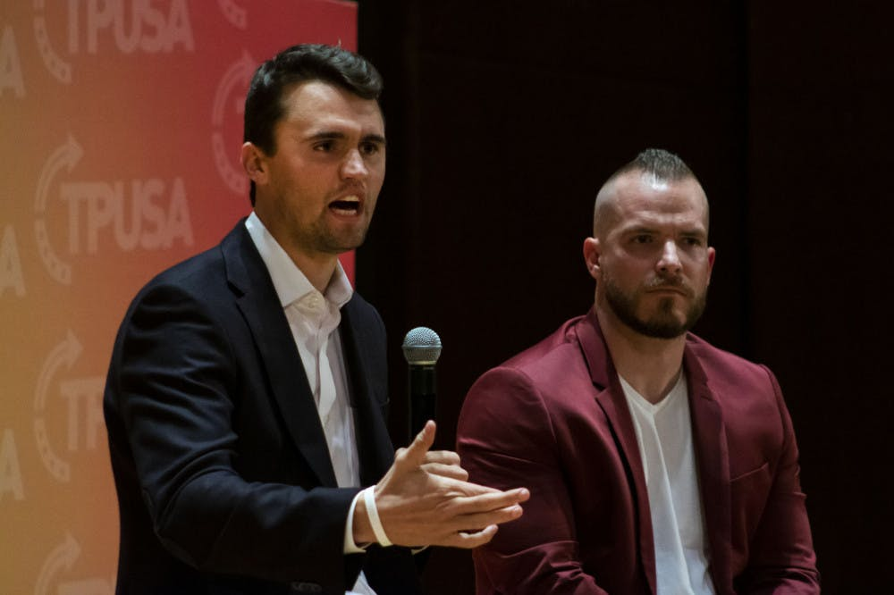 <p>Charlie Kirk, leader of Turning Point USA, and Graham Allen, political speaker, answer questions from an audience in University Auditorium. Kirk was one of several conservative figures to criticize UF for suspending three student groups for violating university COVID-19 policies.</p>