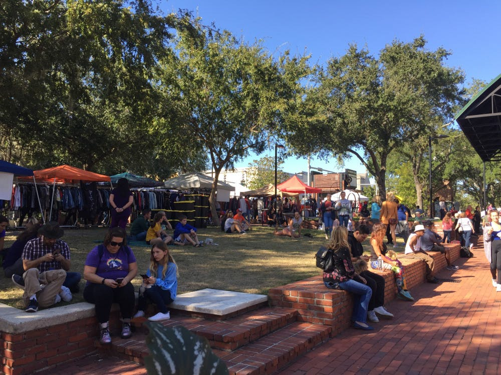 """<p><span style=""""background-color: #ffffff;""""><span style=""""color: #000000; font-family: arial, sans-serif;"""">Gainesville community members visit the Florida Vintage Market at Bo Diddley Plaza on Nov. 10.</span></span></p>"""