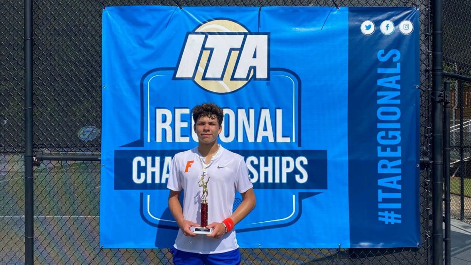 Freshman Ben Shelton stands with the trophy he earned after winning the ITA Fall Circuit Presented by Gwinnett Tennis.