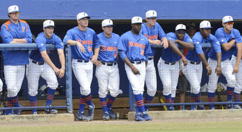 """<p class=""""p1"""">Several members of the Gators baseball team stand on the top steps of the dugout during Florida's 4-0 win against Ole Miss on March 31 at McKethan Stadium. Florida dropped the final game of its series against Tennessee 4-2 on Sunday.</p>"""
