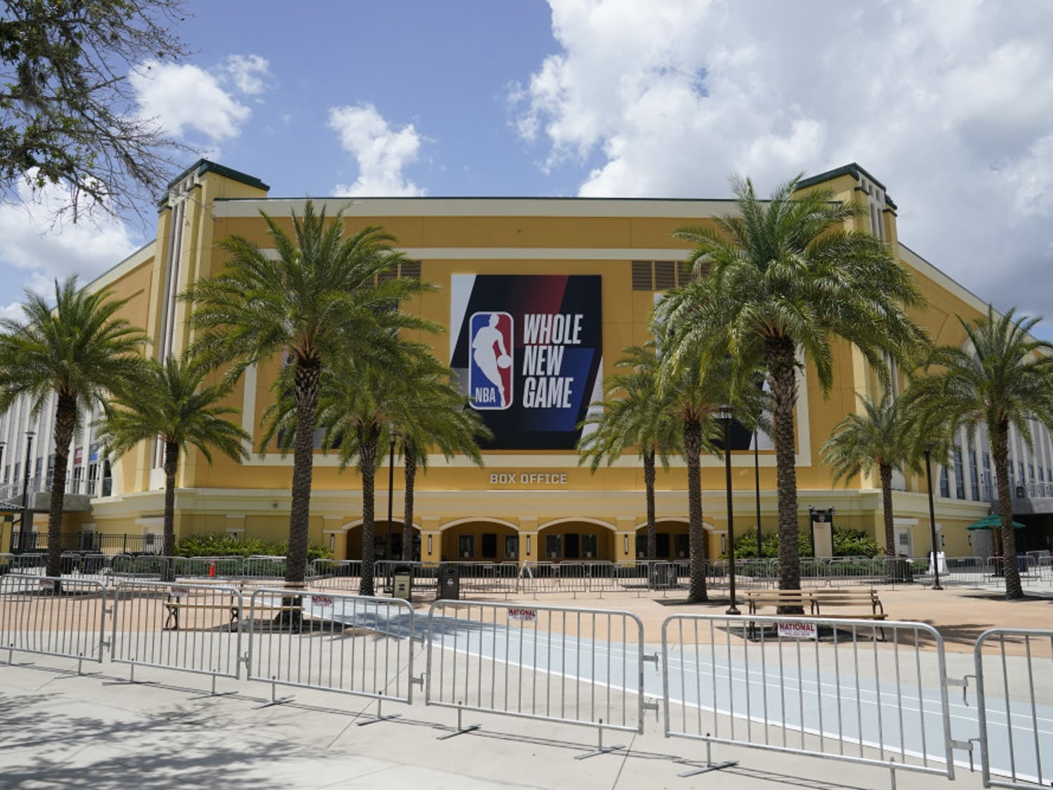 An NBA sign is posted on a basketball arena at ESPN Wide World of Sports Complex Wednesday, July 29, 2020, in Orlando, Fla. NBA games will resume Thursday. (AP Photo/Ashley Landis)