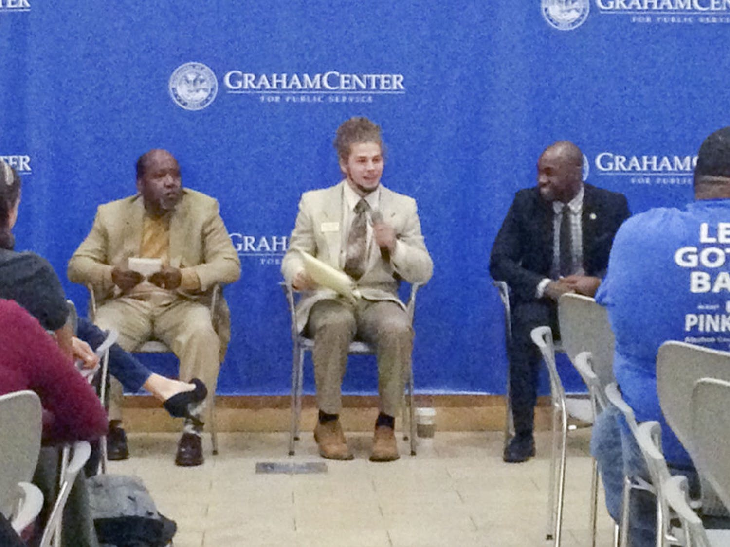 From left: Scherwin Henry, Lucas Jewell and Chris Weaver, all candidates for city commissioner for District 1, speak to an audience at an open forum event hosted by UF College Democrats in Pugh Hall on Friday night.