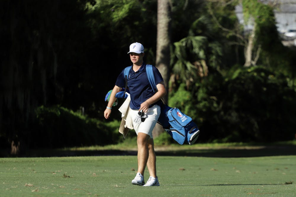 <p>Freshman Tyler Wilkes practices at Mark Bostick Golf Course. Through a day of competition at theGators Invitational, Wilkes shot a 65, his lowest ever score as a Gator</p>