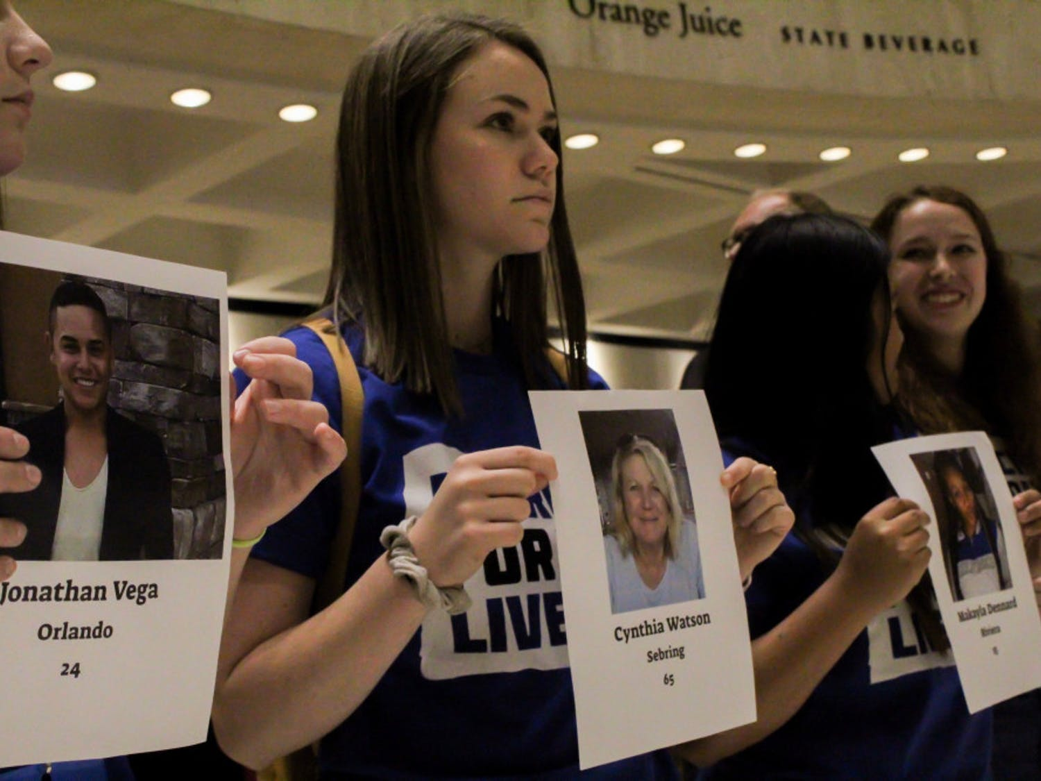 "Lauren Herwitz (center), an 18-year-old UF Health Science and theater freshman and March For Our Lives Gainesville member, protests Florida Senate Bill 7030, which would allow teachers to carry firearms in case of an active shooter, Wednesday afternoon. ""I'm almost in tears, this is just incredibly powerful and emotional,"" she said."