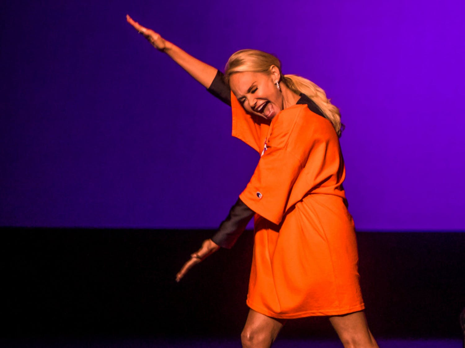 Kristin Chenoweth, the 50-year-old Emmy-winning and Tony award-winning actress and singer, performs a Gator Chomp Sunday evening while wearing a Florida Gators T-shirt during the beginning of her show at the Phillips Center for the Performing Arts. About 1,300 people watched as the Broadway star performed, sharing quirky personal anecdotes between songs.