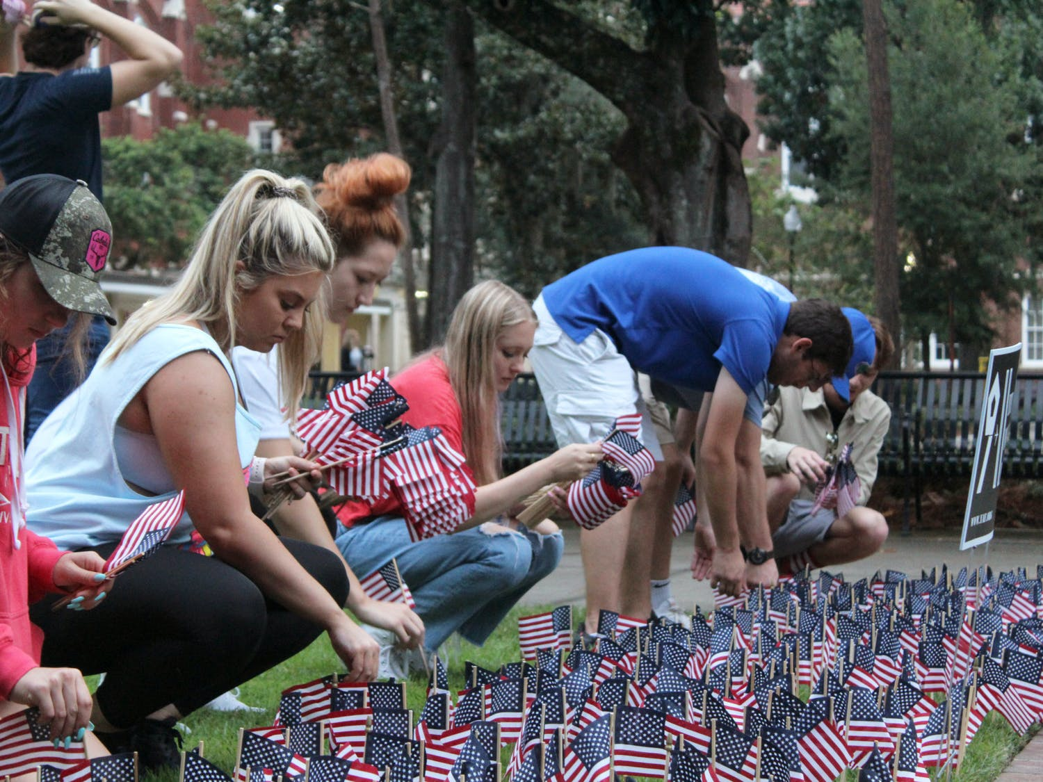 On Saturday, Sept. 11, 2021, city residents and university members across Gainesville commemorated what happened on 9/11, 20 years ago. UF Young Americans for Freedom planted 2,977 flags in the ground to represent the lives lost. About 50 people gathered at Reserve Park to share stories about how 9/11 impacted them. Collegiate Veterans Society members, firefighters and friends met at Ben Hill Griffin Stadium to climb the steps to honor those who climbed the tower stairs and saved thousands of lives.