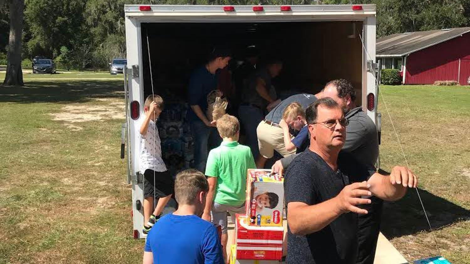 Members of Anthem Church partner with Concept Companies to fill a 24-foot trailer with donations of food, water, fuel and other resources to be delivered in the Panhandle.