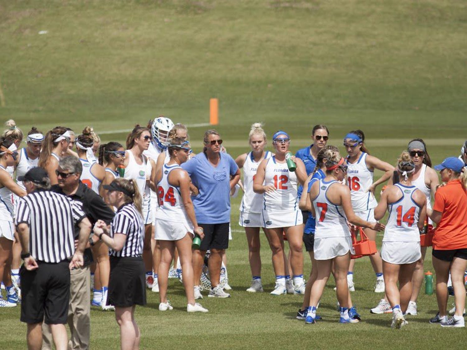 UF lacrosse head coach Amanda O'Leary stands in the center of her players during Florida's 15-8 win against Denver on March 25, 2017, at Donald R. Dizney Stadium.