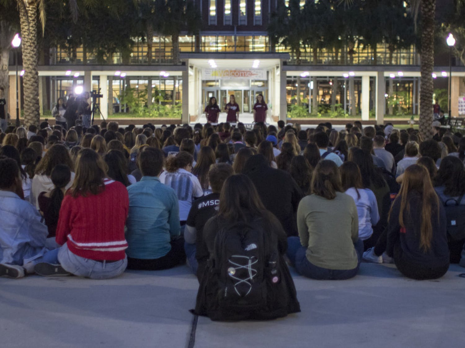 More than 200 people listen to six speakers Thursday on Plaza of the Americas during the vigil for the one-year anniversary of the Marjory Stoneman Douglas shooting.