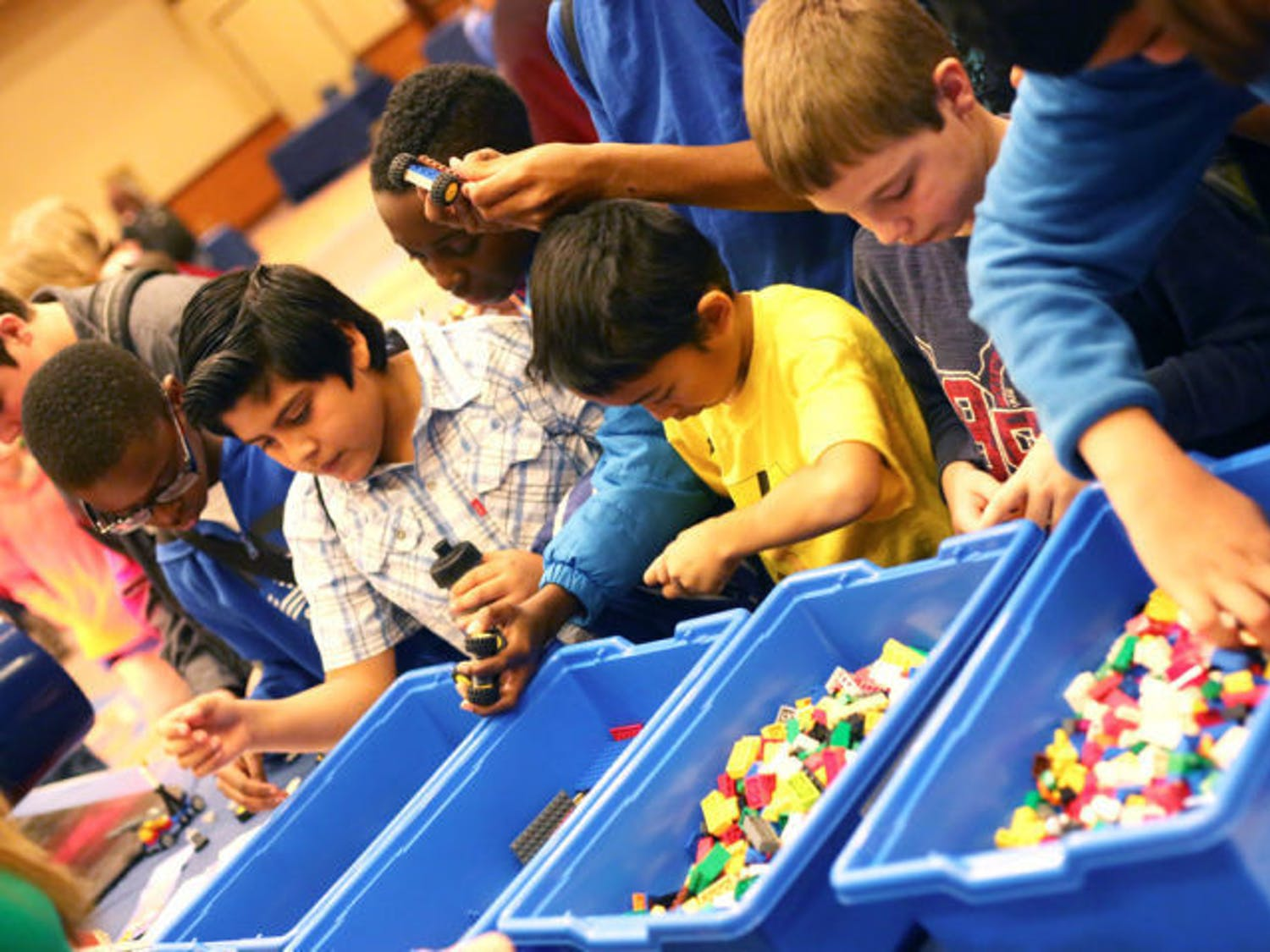 Gainesville elementary and middle school students play with Legos in the Reitz Union Grand Ballroom on Tuesday during the Engineering and Science Fair Day 1. The fair is part of UF's Engineers' Week.