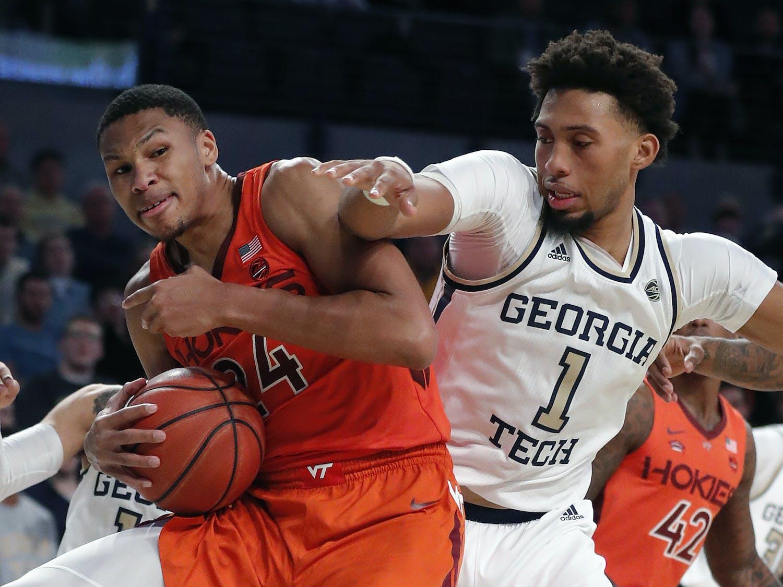 Virginia Tech forward Kerry Blackshear Jr. (24) and Georgia Tech forward James Banks III (1) vie for a rebound during the second half of an NCAA college basketball game in Atlanta.